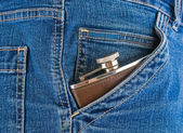 Flask in his pocket — Stock Photo