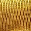 Stock Photo: Metal mesh grate gold background