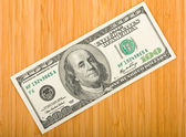 Money on a bamboo board — Stock Photo