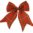 Red bow out of the Scottish material — Stock Photo