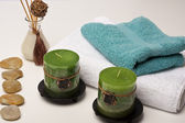 Spa candles, fragrance and towels — Stock Photo