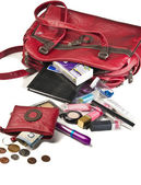 Necessary things in red woman handbag — Stock Photo
