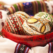 Stock Photo: Painted Easter eggs on clay pottery