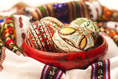 Painted Easter eggs on clay pottery — Stock Photo