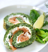 Spinach and salmon roulade — Stock Photo