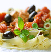 Tagliatelle with basil and olives — Stock Photo