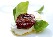 Dried tomato mozarella and basil — Stock Photo
