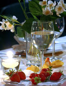 Strawberry and jasmin on evening party — Stock Photo