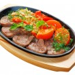 Stock Photo: Fried tongue with vegetables on carving