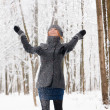 Beautiful ginger-haired girl in winter forest — Stock Photo