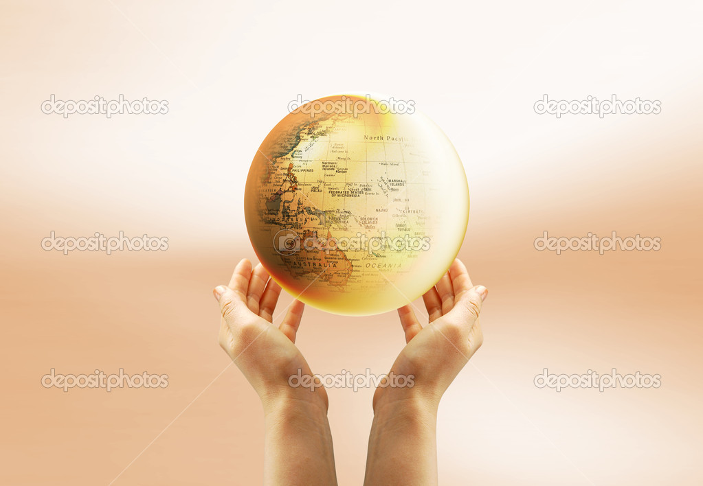 Yellow Earth in the sky and a hand — Stock Photo #1692201