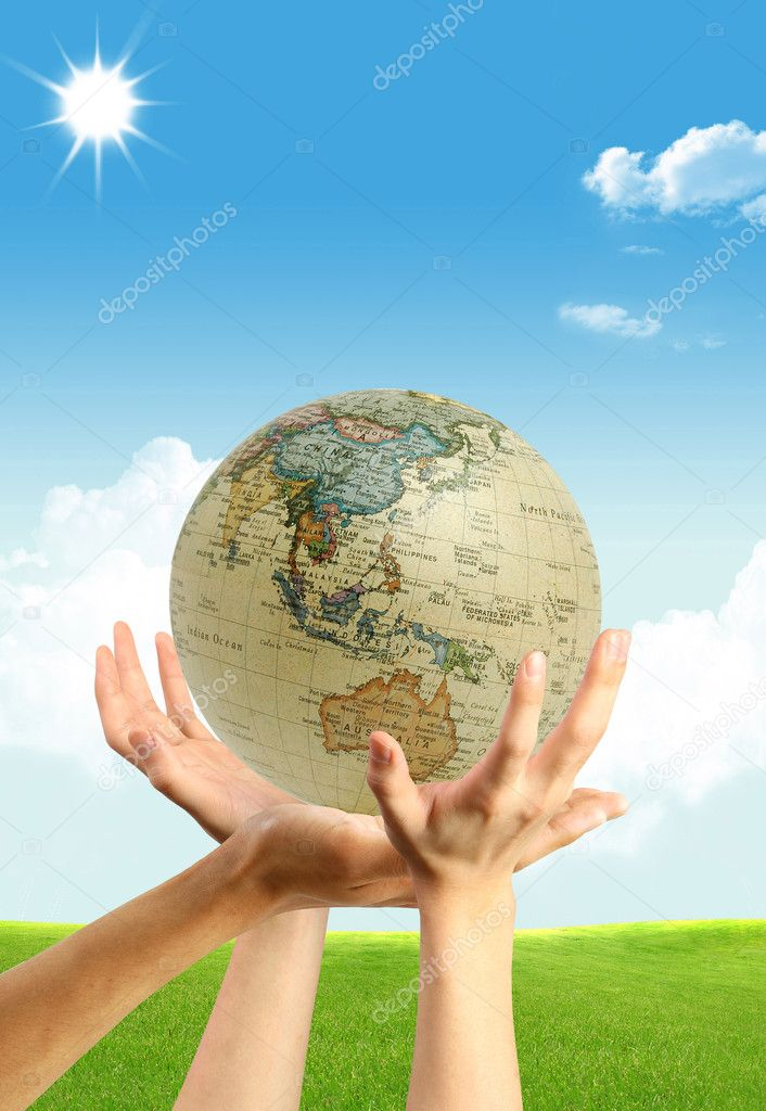 Three hands and a globe on the blue shining sky background — Foto de Stock   #1694808