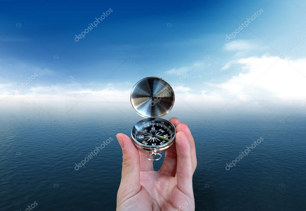 A Seaman who want to find the way with a compass — Stock Photo #1696149