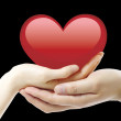 Nice, red heart and two hands — Stockfoto