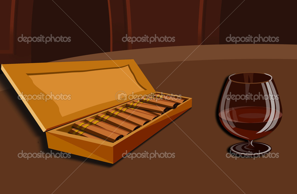It is a tasty cup of cognac with a cigar  Stock Photo #1806497