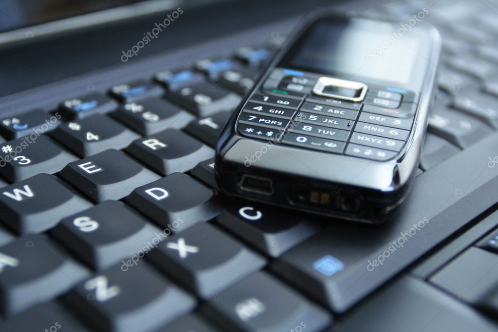 Mobile phone on laptop keyboard as a business concept  Stock Photo #1921815