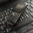 Cell phone and laptop keyboard — Foto Stock