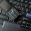 Stock Photo: Mobile phone and laptop keyboard