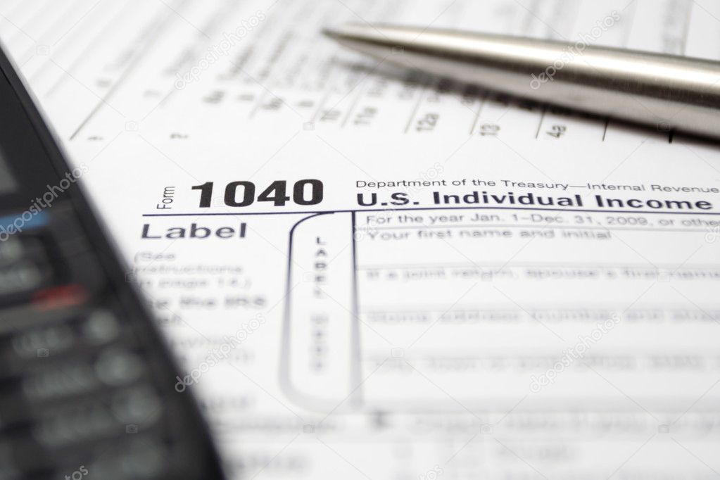 1040 US tax return form, cell phone and silver pen. — Stock Photo #2376885