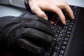 Computer theft with hands on laptop — Stock Photo