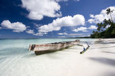 White sand beach with boat — Stock Photo