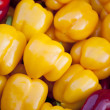 Yellow sweet peppers background - Stockfoto