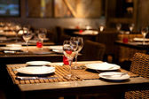 Fine table setting in gourmet restaurant — Stok fotoğraf