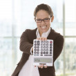 Business woman showing a calculator — Stock Photo