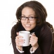 Smiling young beautiful girl with a cup — Stock Photo