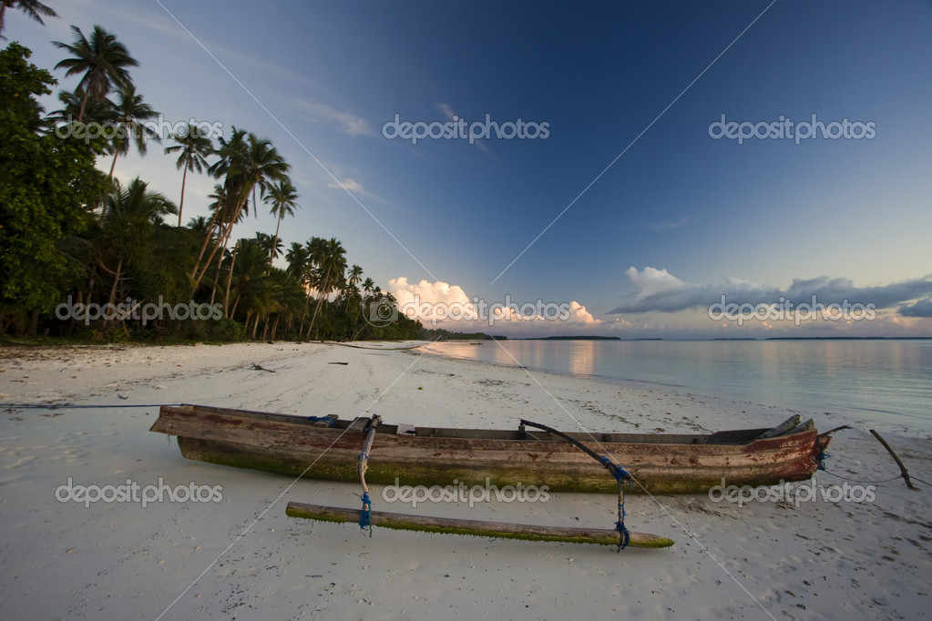 White sand beach with boat at sunset — Stock Photo ...