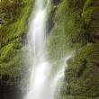 Stock Photo: Waterfall with mossy rocks