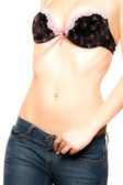 Young healthy girl in bra and jeans — Stock Photo