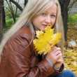 Pretty girl with yellow leaves — Stock Photo