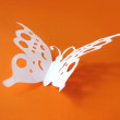 Butterfly from paper on bright backgroun — Stock Photo