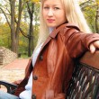 Pretty girl in jacket, sitting — Stock Photo