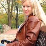 Pretty girl in jacket, sitting — Stock Photo #1628722