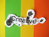 Creative word cut from paper — Stock Photo