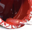 Stock Photo: Red paint and old used brush