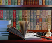 Books in library and glasses — Stock Photo