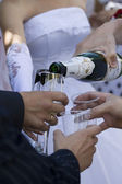 Newlyweds poured champagne on the weddin — Stock Photo