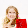 Smiling girl with gift box — Stock Photo #1650775