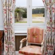 Stock Photo: Armchair close to window