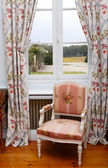 Armchair close to window — Stock Photo