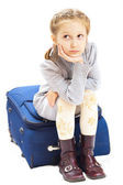 Sad girl with suitcase — Stock Photo