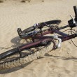 Royalty-Free Stock Photo: Bike laying on a sand