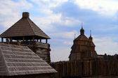 Wooden village. Watchtower and church — Stock Photo