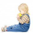 Sitting child with the apple — Stock Photo #1694793