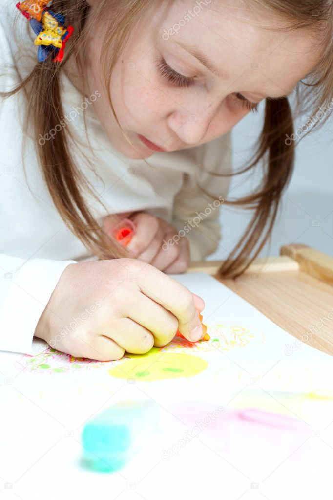 Young girl making her drawing with the soft-tip pens  Stock Photo #1694627