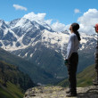Stock Photo: Two climbers looking at mountains