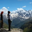 Stock Photo: Two climbers looking at the mountains